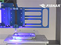 Syringe Dispense with UV Light Cure: F4000 Advance Series Benchtop Robot
